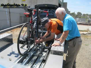 Harry and Allan adjust the trailer for carbon bikes