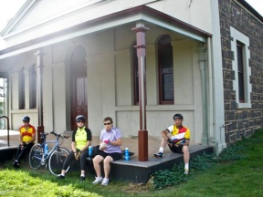 Cyclists take a break at the old Majorca Town Hall (7km south of Maryborough)