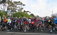 The riders bunch at the start for a slow, non-competitive ride