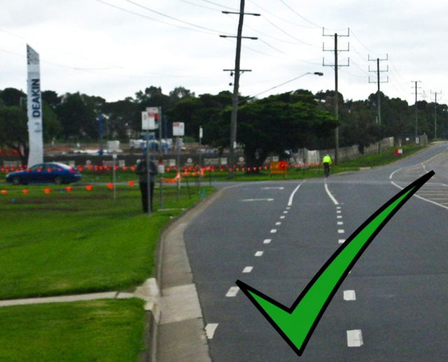 Upper Deakin entrance. Bike lane goes straight ahead. Left turning traffic must give way to cyclists before entering the left turn lane.