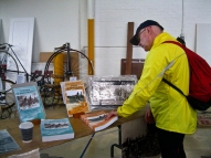 Mike checks out the first two volumes of A Whirr of Many Wheels