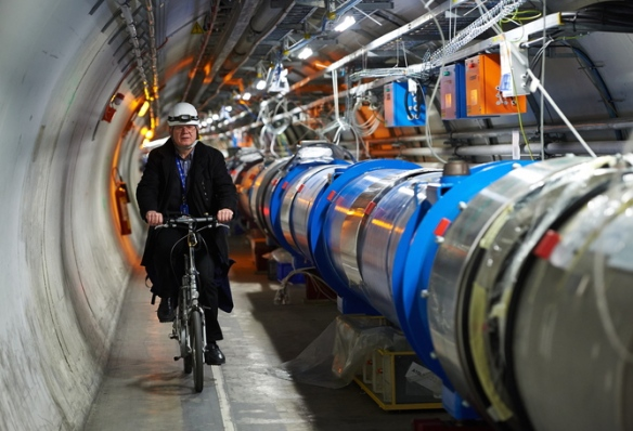epa04692708 (FILE) File picture dated 26 November 2013 shows Polish scientist, engineer, Andrzej Siemko riding a bike next to the LHC accelerator experiment (Large Hadron Collider) at the European Organization for Nuclear Research CERN in Meyrin near Geneva, Switzerland, as he and colleagues from Polandare taking part in the modernization of the accelerator. According to media reports on 05 April 2015, the LHC is due to reopen early April 2015 after two years shutdown for refurbishment and upgrades. CERN revealed that teams have been successfully testing the machine after some technical issues occurred on 21 March delayed its restart. The world most powerful accelerator will smash protons together with approximately the double of the energies reached in the past. Physicists believe that the particle collider will lead to revolutionary discoveries broadening our understanding of the universe and physics.  EPA/ADAM WARZAWA POLAND OUT