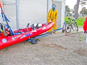 The back wheels of the trailer are integrated with the kayak and fold up when on the water.