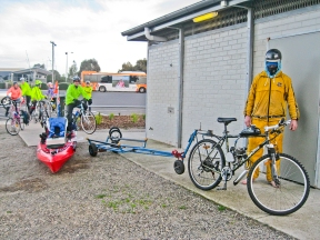 Powered bicycle with purpose built Kayak trailer.