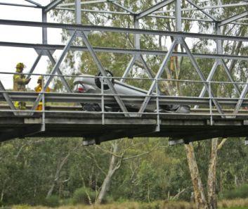 Flipped car on Queen's Park Bridge