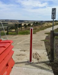 Bollards obstructing exit from Ted Wilson Trail near Church Street