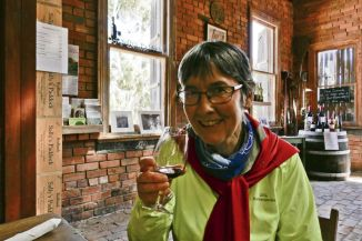 Sally checks her signature 'Sally's Paddock' wine