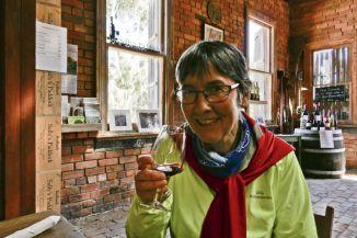 Sally checks her signature 'Sally's Paddock' wine