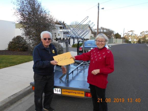 Allan hands the paperwork to Helen (President)